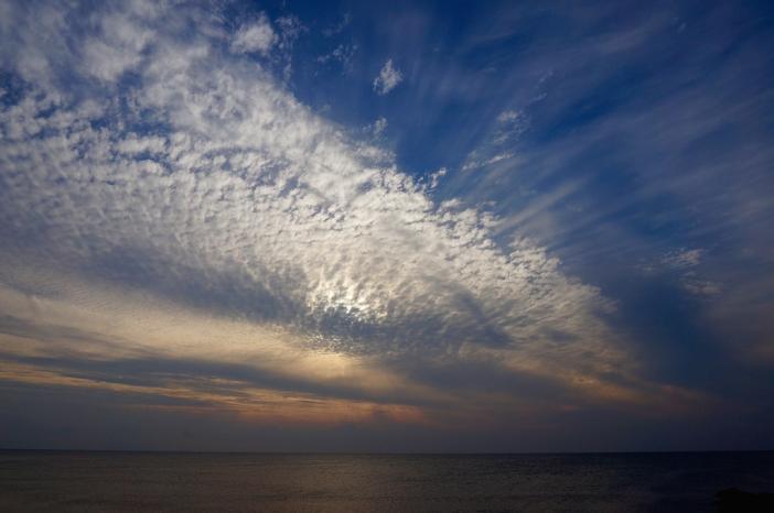 Dag 5: na regen voor het einde van de dag toch nog blauwe lucht en een waterige zonsondergang
